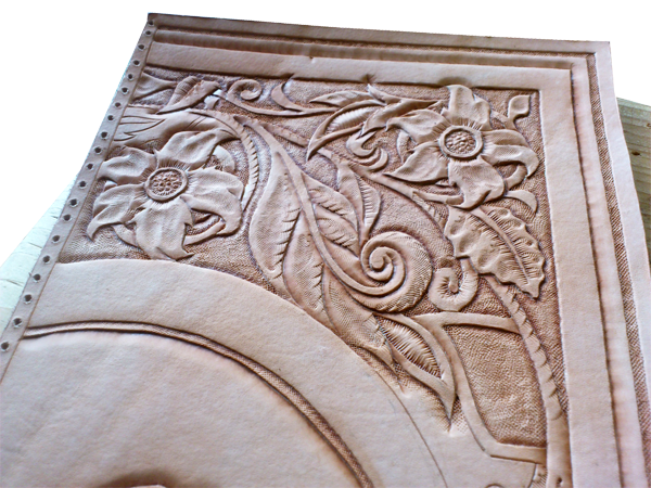 book cover with leather carving